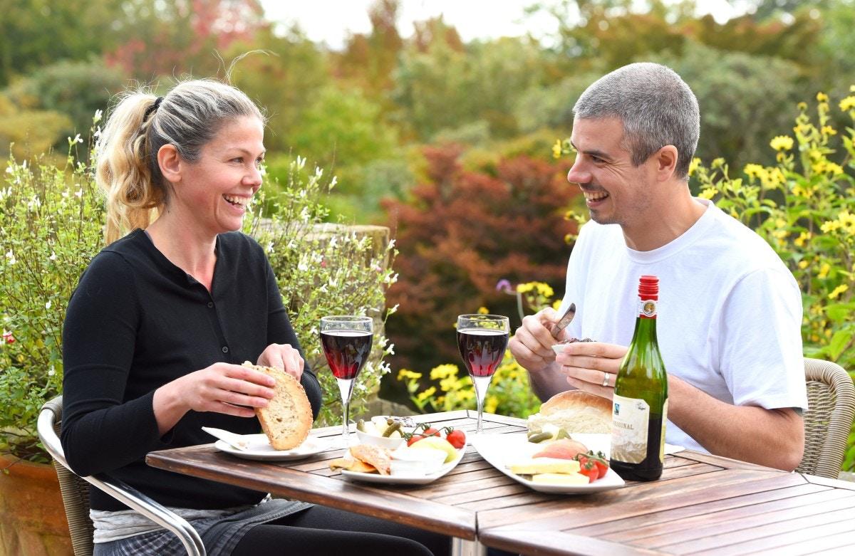 Couple enjoying lunch at Furzey Gardens